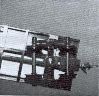 Close view of the box car shows the Kadee No 5 coupler Installed, and truck screwed into place.""